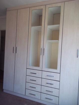 KITCHENS AND FITTED WARDROBES
