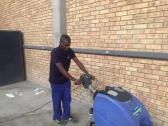 Walk behind scrubber