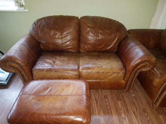 Brown matching leather sofa, loveseat, chair and ottoman