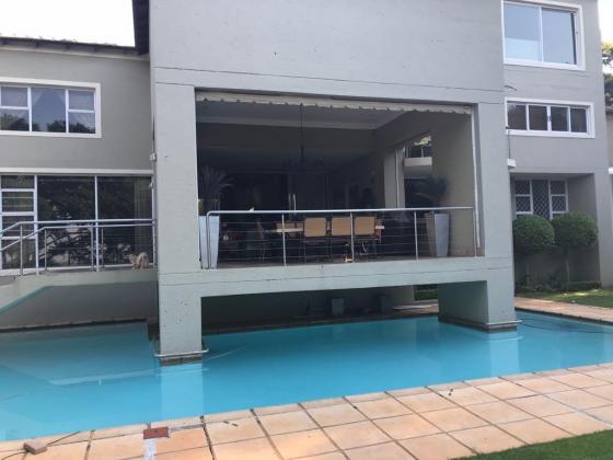 TOP OF THE RANGE 5 BEDROOM HOME WITH ALL EXTRA'S in Waterkloof, Gauteng