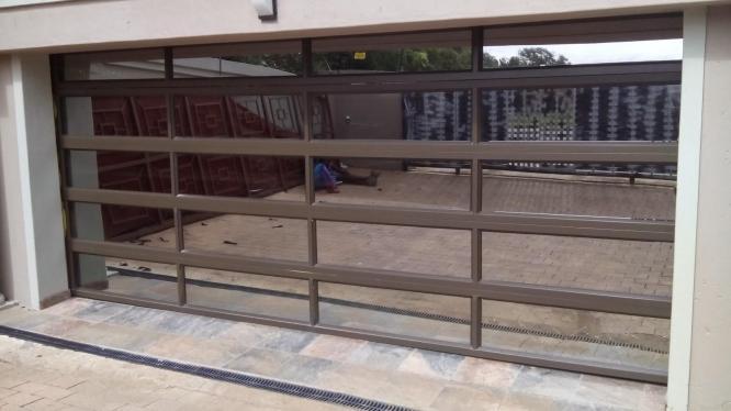 Aluminium Windows and Doors, Garage Doors, Shop Fronts and Glass Balustrades