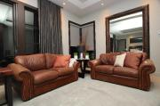 Rich brown leather loveseats