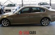 2006 BMW 323i A/T (E90)