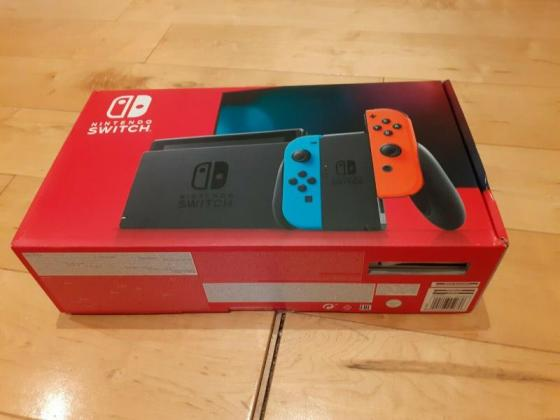 Nintendo Switch 32GB Console Neon Red/Blue + Zelda Breath of the Wild Bundle